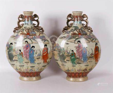 A pair of polychromed so-called moon vases, Japan, 20th cent
