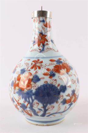 A baluster-shaped Chinese Imari pointed bottle, entertained