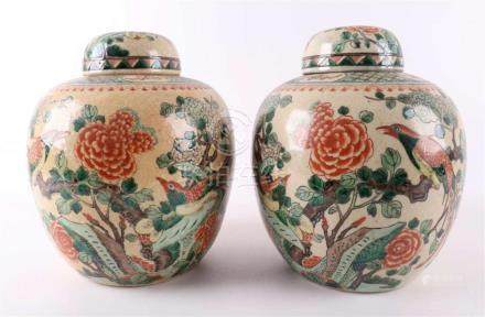 A pair of spherical porcelain ginger pots, China in the earl