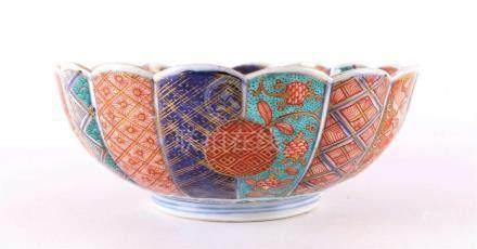 A sculpted porcelain Imari bowl rebellion ring, Japan, Meiji
