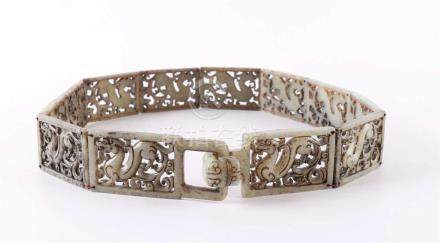 A stabbed jade / serpentine articulated belt, China 20th cen