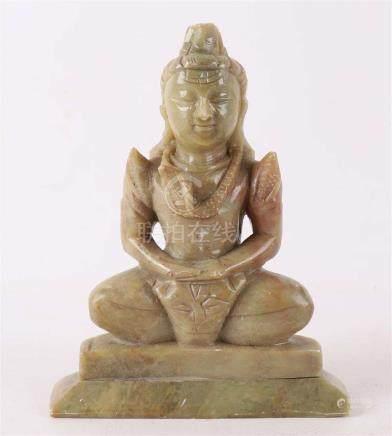 A green natural stone sitting Buddha, India 20th century.