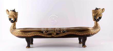 A carved wooden offering dish with decoration of dragons, In