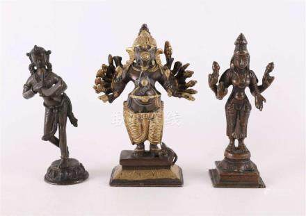 A brown patinated, partly gilded, bronze Ganesha, 20th centu