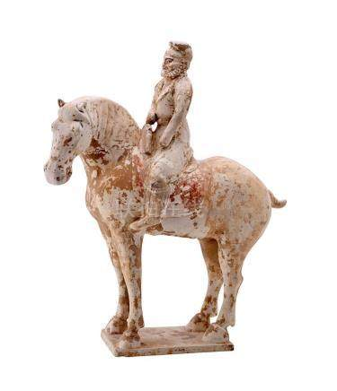A TANG-STYLE PAINTED POTTERY FIGURE OF AN EQUESTRIAN 37 cm h