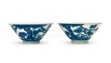A PAIR OF BLUE AND WHITE 'PINE AND DEER' WINE CUPS QING DYNA