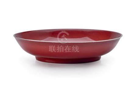 A COPPER-RED GLAZED DISH QING DYNASTY 19 cm diameter