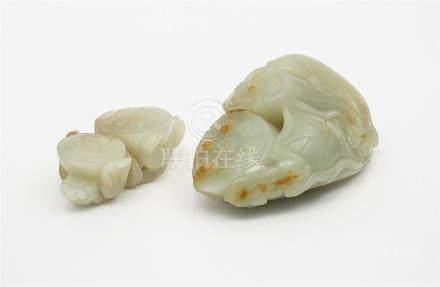 TWO CELADON JADE 'LOTUS' CARVINGS QING DYNASTY (2) 10 cm, 7.