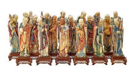 AN IMPRESSIVE SET OF EIGHTEEN CARVED IVORY LUOHANS, 19TH/20T