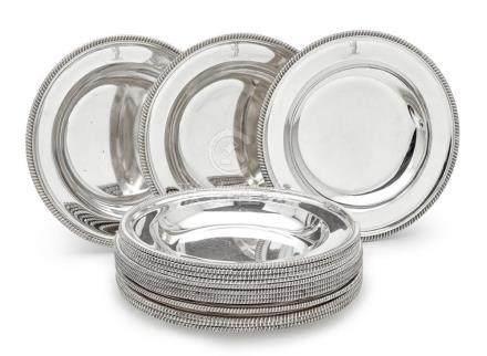 An assembled set of fifteen sterling silver soup plates, 19t