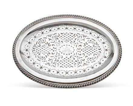 A George IV sterling silver meat platter and an associated s