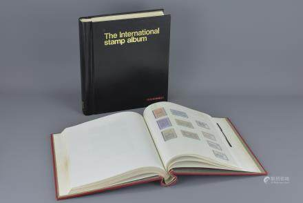 Two Stanley Gibbons Stamp Albums both partially filled with GB and World Stamps, mainly 20th century, mint and used, hinged and never hinged, including two pages of Chinese / China Stamps