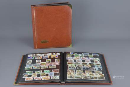 Two Benham Stamp Stock books containing a quantity of mainly mint never hinged stamps, mainly 20th century including few George VI Olympic Games and other Stamps, plus a few first day covers and presentation packs