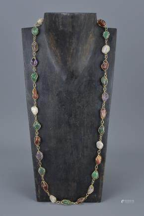 Yellow Metal Necklace containing 30 Coloured Polished Natural Agate Stones