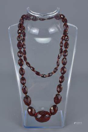 Cherry Amber Coloured Necklace containing 58 Faceted Graduating Beads
