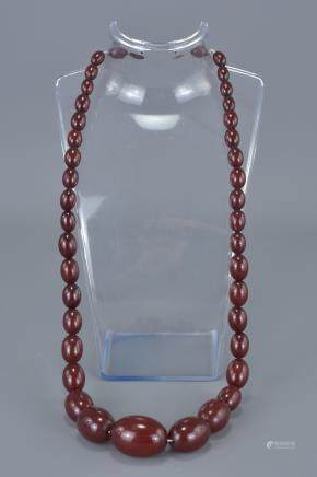 Cherry Amber Bakelite Necklace containing 41 Graduating Ovoid Beads, approx. 60 grams