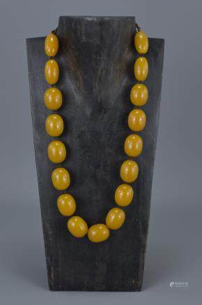 Amber Coloured Necklace containing 17 String Strung Beads, approx. 90 grams