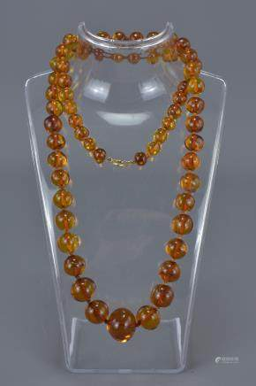 Baltic Clear Amber Bead Necklace containing 63 Graduating Beads, approx. 50 grams