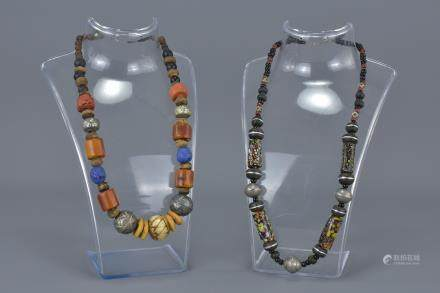 Two Ethnic Necklaces with wooden, stone and white metal beads