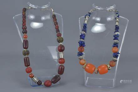 Two Ethnic Necklaces with wooden, resin, white metal and stone beads