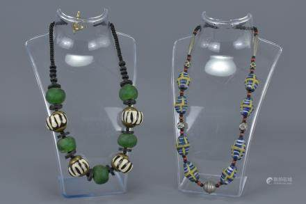 Two Ethnic Necklaces with stone, resin and white metal beads