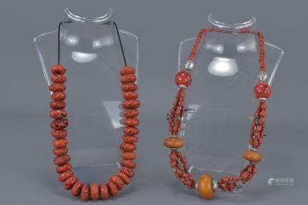 Coral, White Metal and Amber Coloured Bead Necklace together with a Red Stone Bead Necklace