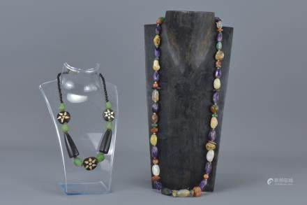 Natural Polished Stone Necklace together with an Ethnic Wooden and Stone Bead Necklace