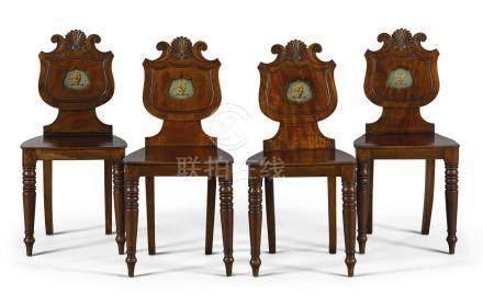 A set of four George IV mahogany hall chairs, circa 1830