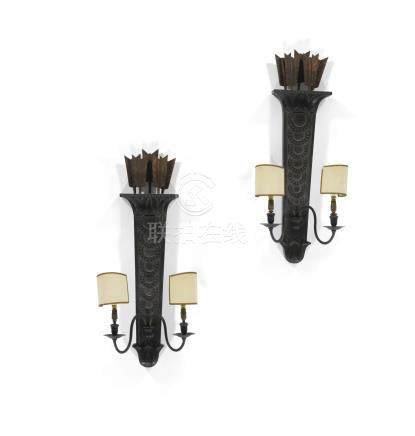 A pair of neo-classical style ebonisedand parcel-gilt wall lights, circa 1920, possibly Maison Jansen