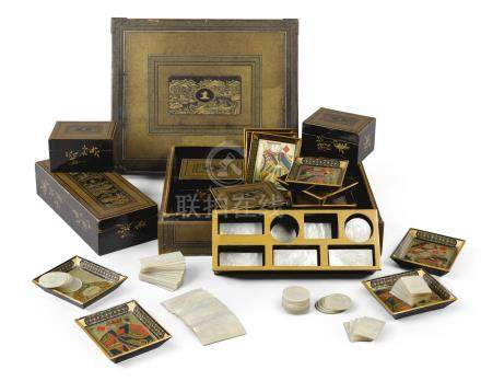 A Chinese Export armorial lacquer gaming box and mother-of-pearl counters, early 19th century
