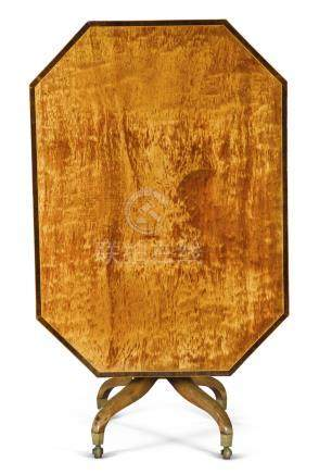 A George III octagonal satinwood and mahogany tilt-top table, late 18th century, in the manner of Gillows