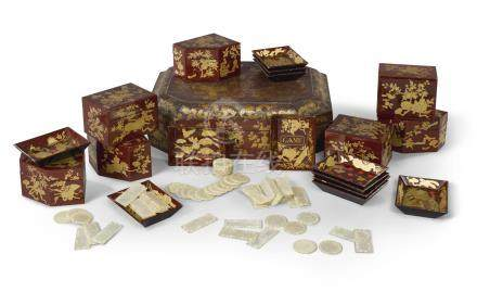 A Chinese Export red and giltlacquer gaming box and mother-of-pearl counters, early 19th century