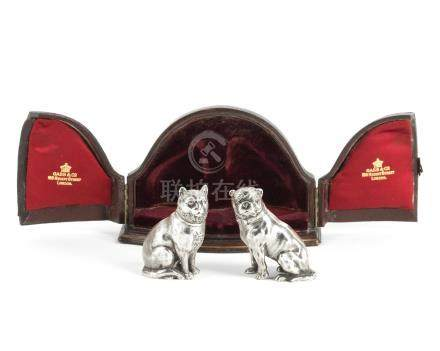 A pair of Victorian novelty silver condiment shakers by Edward H Stockwell, London 1877