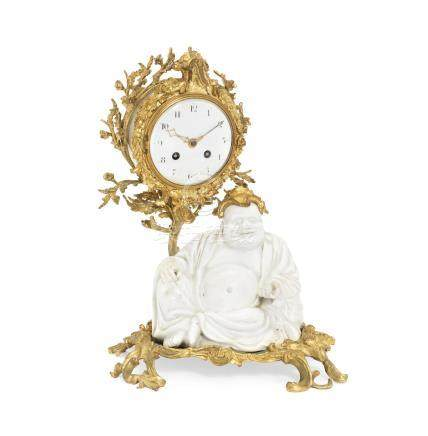 A late 19th century French gilt bronze and 'blanc-de-chine' porcelain figural mantel clock in the Chinoiserie taste, the porcelain probably Samson, the movement stamped Japy Freres,