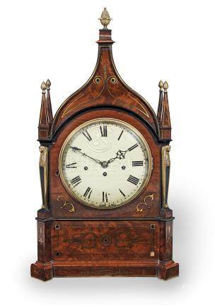 An early 19th century mahogany and brass inlaid triple fusee chiming bracket clock in the Gothic taste, the dial indistincly signed Tanner