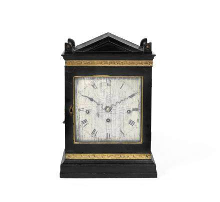 A Regency ebonised quarter chiming twin fuse bracket clock with pull repeat in the Egyptian taste, the dial signed for George Cobbett, London