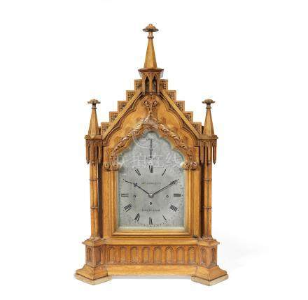 A late 19th century oak triple fusee chiming bracket clock in the Gothic style, the dial signed John Howlett, Cheltenham