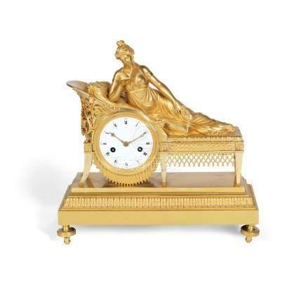 A 19th century French gilt bronze figural mantel clock in the Empire taste