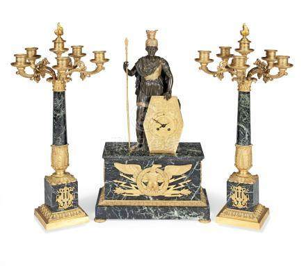 An early 20th century gilt and patinated mounted Verdi Antico marble figural clock garniture the movement signed 'H.Luppens, Paris,' and with Samuel Marti pastille mark (3)