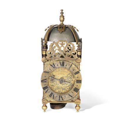 A brass lantern clock the dial signed Charles Garrett, London