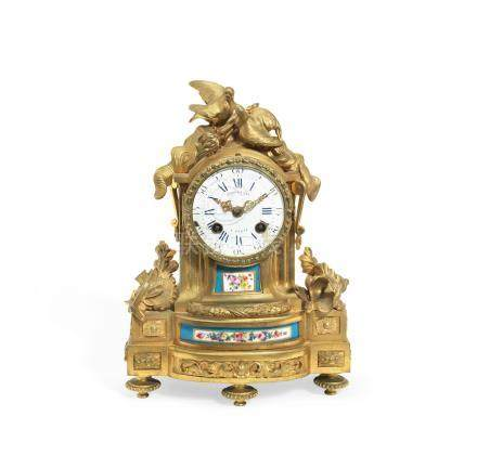 A mid 19th century gilt bronze and sevres style porcelain mounted mantel clock in the Louis XVI style, the dial signed 'Ambrosoni a Paris,'