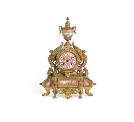 A late 19th century French gilt metal and Sevres style porcelain mantel clock  in the Louis XVI style,