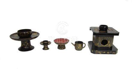 Three black and gold-lacquer sake stands together with a small jug and a sake cup Meiji era (5)