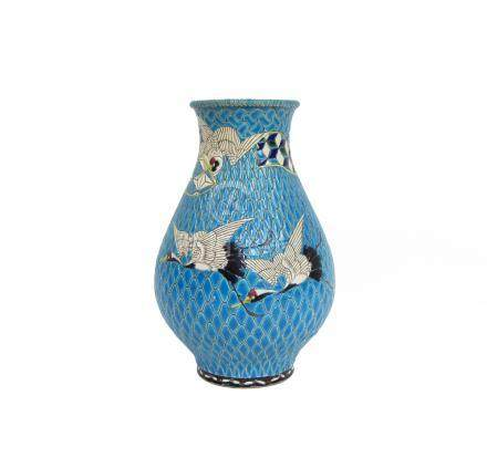 An enamelled earthenware vase Circa 1900