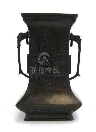 An 18ct century Chinese brown patinated bronze two handled vase decorated with stylised leaves and