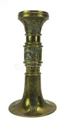 A Chinese brass candlestick of flared form, h.