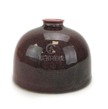 A Chinese sang de boeuf 'beehive' water pot of typical form, six character Kangxi mark to base,