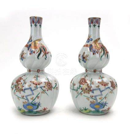 A pair of late 18th/early 19th century Japanese Kakiemon bottle vases of double gourd form,