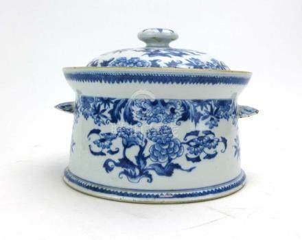 A Chinese blue and white two handled covered dish decorated with blossoming shrubs, w. 23.