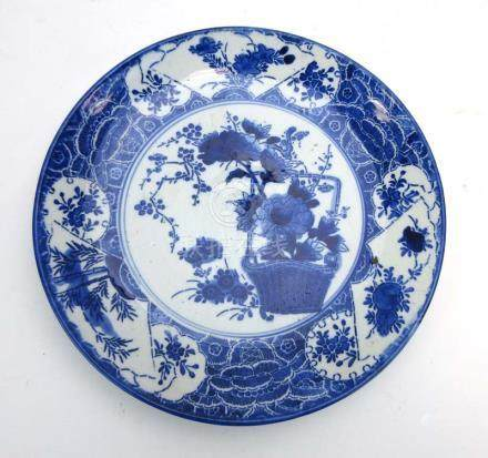 A late 18th/early 19th century Japanese blue and white charger of circular form,